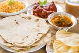 Chapatti Roti or Flat Bread, Curry Chicken, Biryani Rice, Salad, Masala Milk Tea and Papadom. India Photographic Print by  szefei