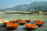 Puja Flowers Offering for the Ganges River in Rishikesh, India Photographic Print by  mazzzur