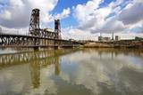 Reflection in Willamette River and Steel Bridge, Portland Oregon. Photographic Print by Craig Tuttle