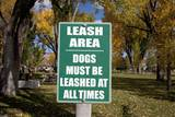 Dogs Must Be Leashed Sign in Front of Park in Ridgeway Colorado Photographic Print by Joseph Sohm