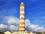 Barra Lighthouse, Costa Nova, Aveiro with Large Clouds Photographic Print by Terry Eggers