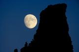 Full Moon beside Rock Photographic Print by Momatiuk - Eastcott