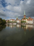 View of Petrikirche from Fussgangerbrucke on Trave Canal Photographic Print by Guido Cozzi