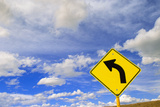 Curve Road Sign on Highway against Sky Photographic Print by Momatiuk - Eastcott