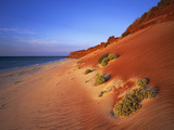 Red Sand Dunes before an Australian Coastline Photographic Print by Theo Allofs