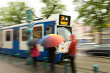 People Waiting for Streetcar on Damrak Street Photographic Print by Guido Cozzi