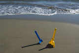 Toy Shovels in Sand Photographic Print by Chris Sattlberger
