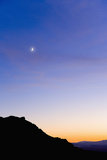 New Moon and Colorful Night Sky above Desert Photographic Print by Momatiuk - Eastcott