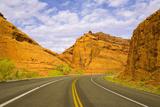 Highway among Steep Red Sandstone Buttes Photographic Print by Momatiuk - Eastcott