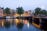 Amsterdam and the Amstel Canal Fotografisk tryk af Guido Cozzi