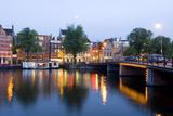 Amsterdam and the Amstel Canal Fotografie-Druck von Guido Cozzi