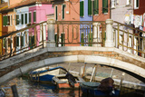 Footbridge over Canal with Brightly Colored Houses Photographic Print by Paul Seheult