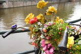 Bicycle with Flowers beside a Canal Photographic Print by Guido Cozzi