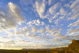 Cumulus Clouds over Sandstone Buttes at Sunrise Photographic Print by Momatiuk - Eastcott