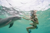 Woman with Bottlenose Dolphin Photographic Print by Stuart Westmorland
