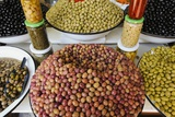 Olive Stand in a Souk in the Medina in Marrakech Photographic Print by Sergio Pitamitz
