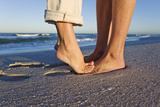 Feet of Couple Hugging on Beach Photographic Print by Martin Harvey