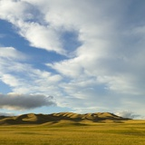 Grazing Farmland Hills and Cumulus Clouds, Evening, South Island, New Zealand Photographic Print by Momatiuk - Eastcott