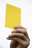 Hand Holding Yellow Card Photographic Print by Paul Seheult