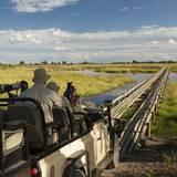 Safari Vehicle Crossing Bridge Photographic Print by Michele Westmorland