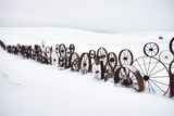 Fence Made of Old Iron Wheels on Snow Photographic Print by Terry Eggers