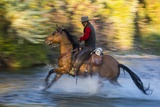 Cowboy Riding through River on a Horse Photographic Print by Terry Eggers
