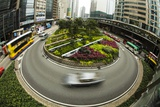 Traffic Circle in down Town Hong Kong with Motion Photographic Print by Terry Eggers