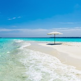 Beach Umbrella in the Maldives Photographic Print by John Harper
