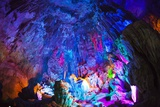 Multi Colored Lights in the Reed Flute Cave Photographic Print by Terry Eggers