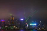 Nightly Light Show of the City of Hong Kong Draped in Fog Photographic Print by Terry Eggers