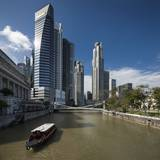 Boat on the Singapore River, the Cavenagh Bridge and the Downtown Photographic Print by Massimo Borchi