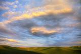 Rolling Hills of Green Spring Wheat and Evening Bright Clouds Photographic Print by Terry Eggers