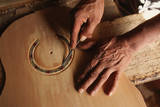 Carving a Guitar Face Photographic Print by Danny Lehman