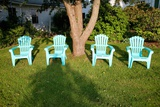 Turquois Lawn Chairs and Green Grass at Sunset Photographic Print by Joseph Sohm