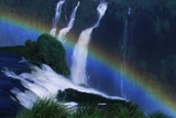 Rainbow over Iguazu Falls Photographic Print by W. Perry Conway