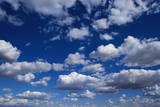Puffy White Clouds in a Blue Sky Photographic Print by Rick Doyle