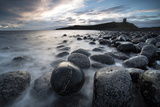 View Towards the Ruin of Dunstanburgh Castle from the Beach of Basalt Boulders Photographic Print by Lee Frost