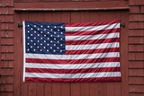 US Flag Displayed on Red Barn, New England Photographic Print by Joseph Sohm