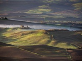 Morning Light over the Fields of Winter Wheat above the Tuscan Landscape Photographic Print by Terry Eggers