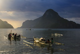 Outrigger Boat at Sunset in the Bay of El Nido, Bacuit Archipelago, Palawan, Philippines Photographic Print by Michael Runkel