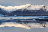 View over Jokulsarlon Glacial Lagoon Towards Snow-Capped Mountains and Icebergs Photographic Print by Lee Frost