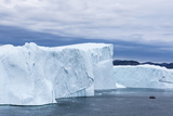 A Zodiac Amongst Huge Icebergs Calved from the Ilulissat Glacier, Ilulissat, Greenland Photographic Print by Michael Nolan