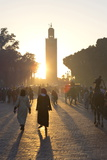 View Towards the Koutoubia Minaret at Sunset with Local People Walking Through the Scene Photographic Print by Lee Frost