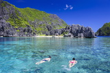 Tourists Swimming in the Crystal Clear Water in the Bacuit Archipelago, Palawan, Philippines Photographic Print by Michael Runkel