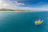 Little Boat in the Blue Lagoon, Yasawas, Fiji, South Pacific, Pacific Photographic Print by Michael Runkel