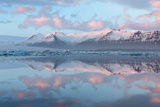 Panoramic View across the Calm Water of Jokulsarlon Glacial Lagoon Towards Snow-Capped Mountains Photographic Print by Lee Frost