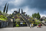 Stone Statues with Colourful Capes in the Pura Besakih Temple Complex, Bali, Indonesia Photographic Print by Michael Runkel