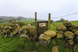 Footpath Gate and Dry Stone Wall Near Elton on a Murky Spring Day Photographic Print by Eleanor Scriven