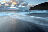 Sea Stacks of Reynisdrangar at Sunrise from the Black Volcanic Sand Beach at Vik I Myrdal Photographic Print by Lee Frost