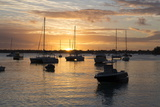 Sunset over the Indian Ocean with Boats in Silhouette on the Calm Water Off the Beach at Gran Baie Photographic Print by Lee Frost